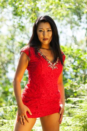 mature Asian woman with red dress Stock Photo