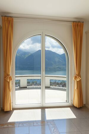 luxury house: window of a luxury house, balcony view Stock Photo