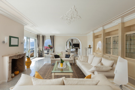 luxury house: living room in luxury house, comfortable white divans