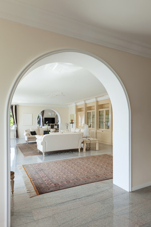 classic interior: living room in luxury house, view from the corridor