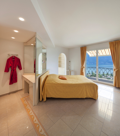 view an elegant wardrobe: Interior of a luxury home, comfortable bedroom