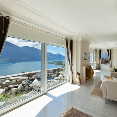 living room in luxury house, big window overlooking the lake Stock Photo