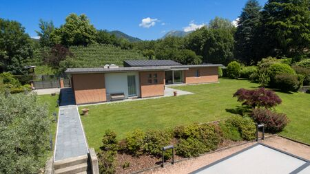 modern home: Modern brick house with garden, outdoors Stock Photo