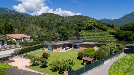 aerial: aerial view of a modern brick house with garden