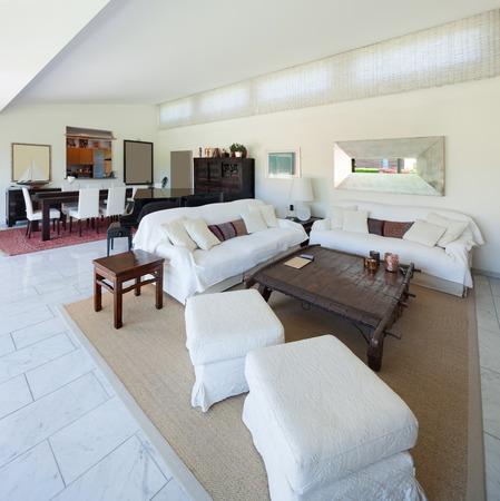 divan: living room of a modern house, white divan, interior