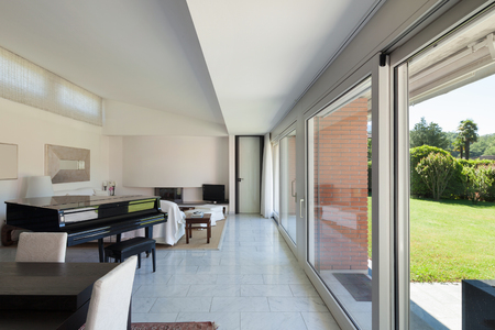 house windows: Lounge of a modern house, big windows, interior