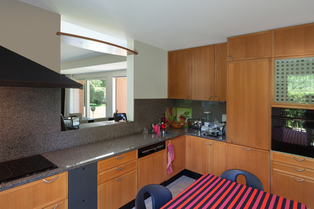 domestic kitchen: Modern house, domestic kitchen with wooden cabinets