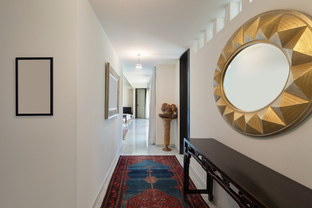 mirror on wall: Corridor of a modern house, carpet on the floor