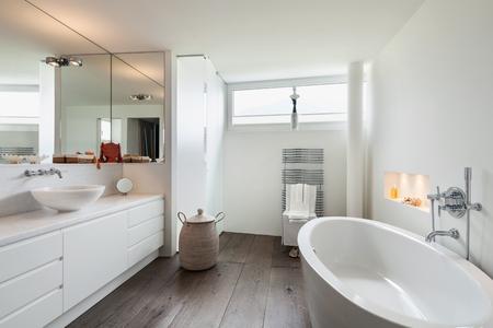bathroom design: comfortable bathroom in modern design, wooden floor Stock Photo
