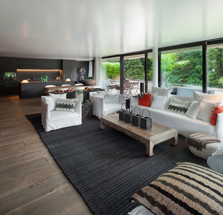 big windows: Modern living room with white divans and big windows