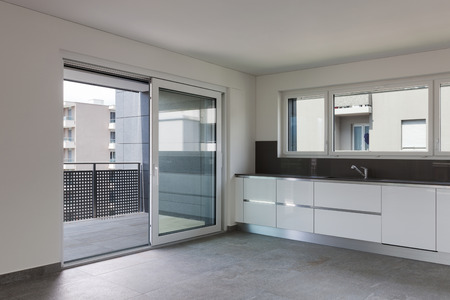 modern apartment: Interior of empty apartment, modern kitchen with balcony
