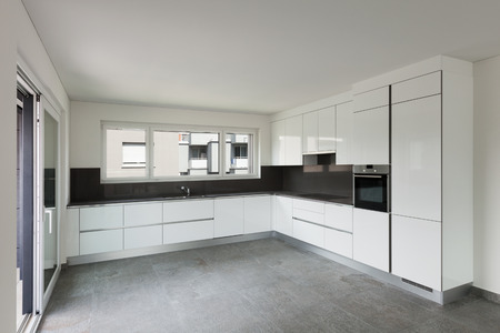 apartment living: Interior of empty apartment, wide living with modern kitchen
