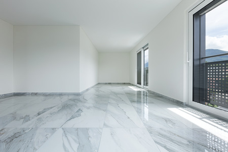Interior of empty apartment, wide room with marble floor