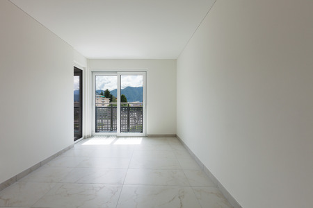 contemporary house: Interior of empty apartment, wide room with marble floor