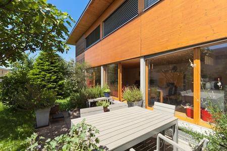 garden styles: Veranda of a wooden house,  modern design Stock Photo