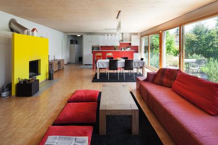 divan: Living room of an eco house, red divan Foto de archivo