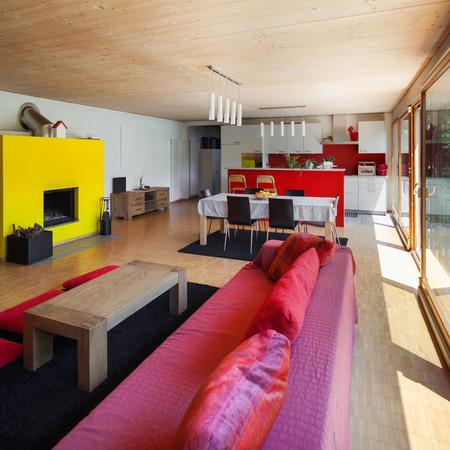 divan: Living room of an eco house, red divan Stock Photo
