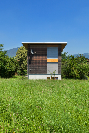 house exterior: eco house, view from the meadow