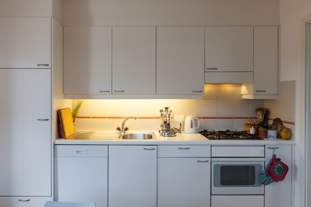 cabinets: front view of a domestic kitchen, cabinets and hob