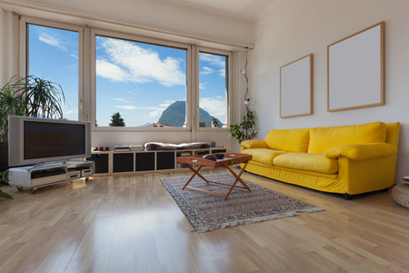 wood room: living room of old apartment, yellow divan and wooden floor