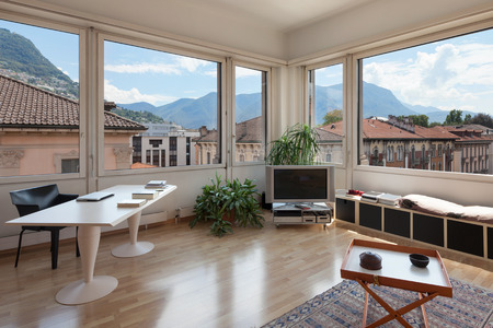 big windows: living room of old apartment, modern desk and big windows Stock Photo