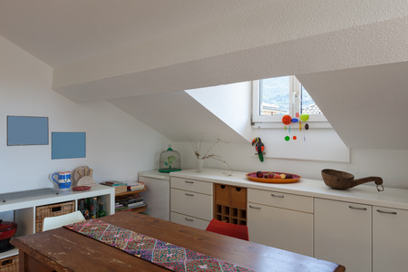 skylights: Kitchen of a loft, old wooden dining table