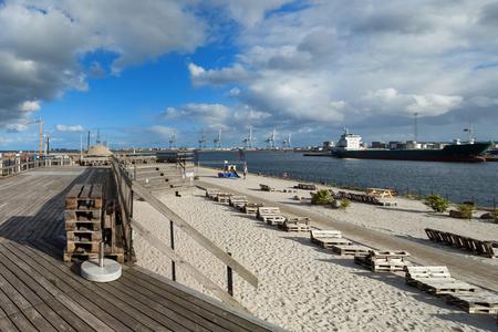 beach at Aarhus in Denmark, harbor in the background Stock Photo