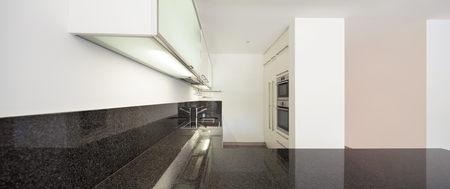 counter top: Interior of empty apartment, domestic kitchen, counter top black marble