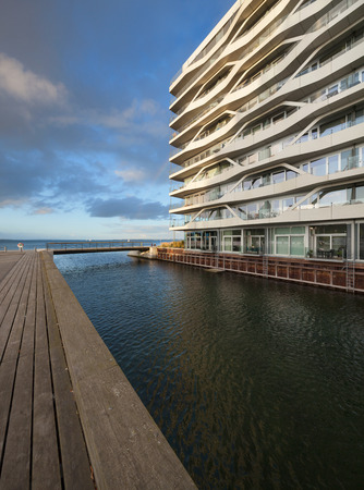 AARHUS, DENMARK - AUGUST 9, 2016: View from external of the Isbjerget Aarhus, residential building in the Aarhus Docklands neighborhood, It is situated on the waterfront on Mariane Thomsens Gade Editorial