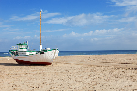 bateau de peche: Fishing boats stranded on the beach at low tide