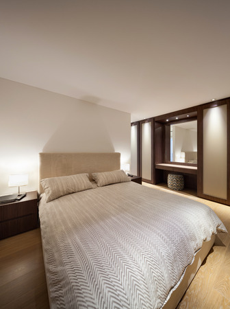 double bed: bedroom of luxury house, comfortable double bed Stock Photo