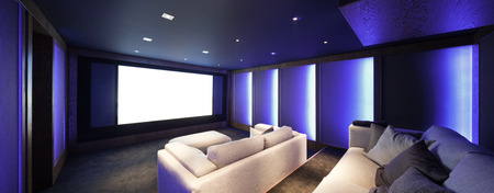home entertainment: Home theater, luxury interior, comfortable divan and big screen