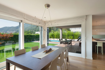 open windows: Wide open space of luxury house, veranda and garden view from the windows Stock Photo