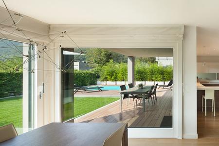 open windows: Luxury home interior, wide open space, veranda and garden view from the windows Stock Photo