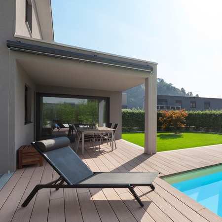 modern house with pool, lounger sun by the pool