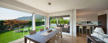 Wide open space of luxury house, veranda and garden view from the windows Standard-Bild