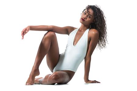Central American girl posing in studio on white background