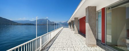 penthouse: Panoramic view from the balcony of an old penthouse, lake and mountains Stock Photo