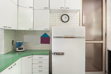 vintage kitchen: Old domestic kitchen of an apartment, vintage refrigerator