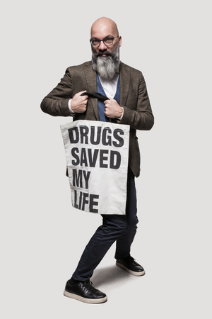 slogan: man shows poster with a slogan, isolated on gray background Stock Photo