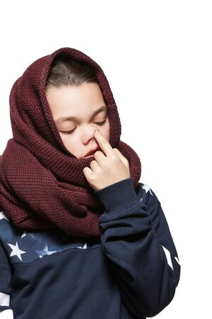 nose picking: Teen girl with a scarf on the head, picking nose, isolated on white background