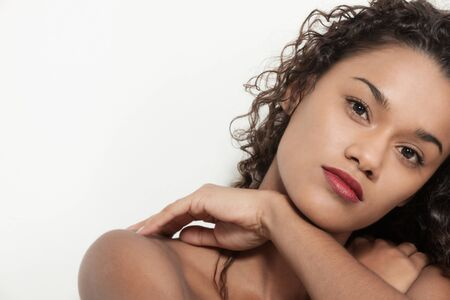 hair studio: Young woman brazilian with curly hair posing in studio, closeup