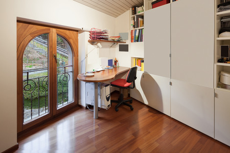 decoracion mesas: Interior of apartment, office room with big cupboard, desk and chair in the corner