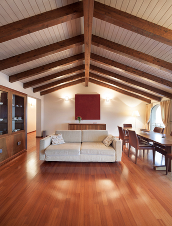 Comfortable, Loft, Living Room With A Divan And Dining Table, Wooden Floor  Stock