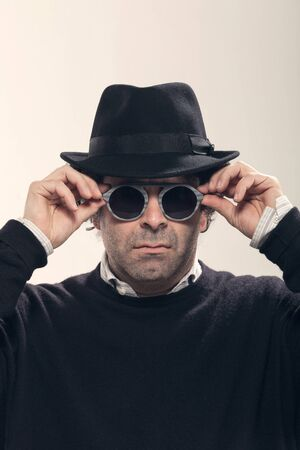 guys: Guy with a black hat and stylish glasses, studio portrait