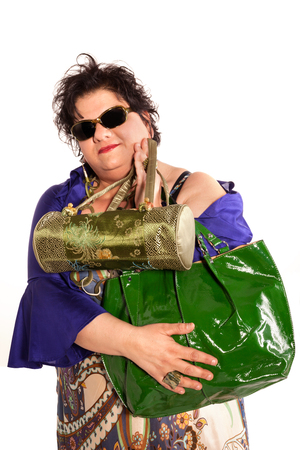 oversized: portrait of cheerful woman with her bags, isolated on white background