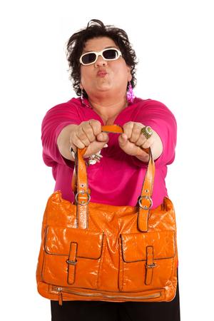 oversize: woman with orange bag Stock Photo