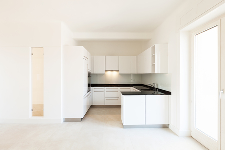 forniture: Wide white kitchen in a modern apartment Stock Photo