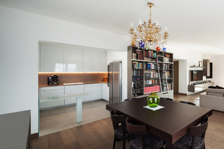 confortable: Large sitting room with dining table in the foreground, interior of apartment