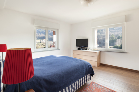 wood floor: Apartment interior, bedroom with wooden floor and white walls Stock Photo